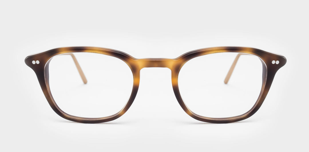 Slim rectangular glasses frame made from tortoise acetate and rose gold legs