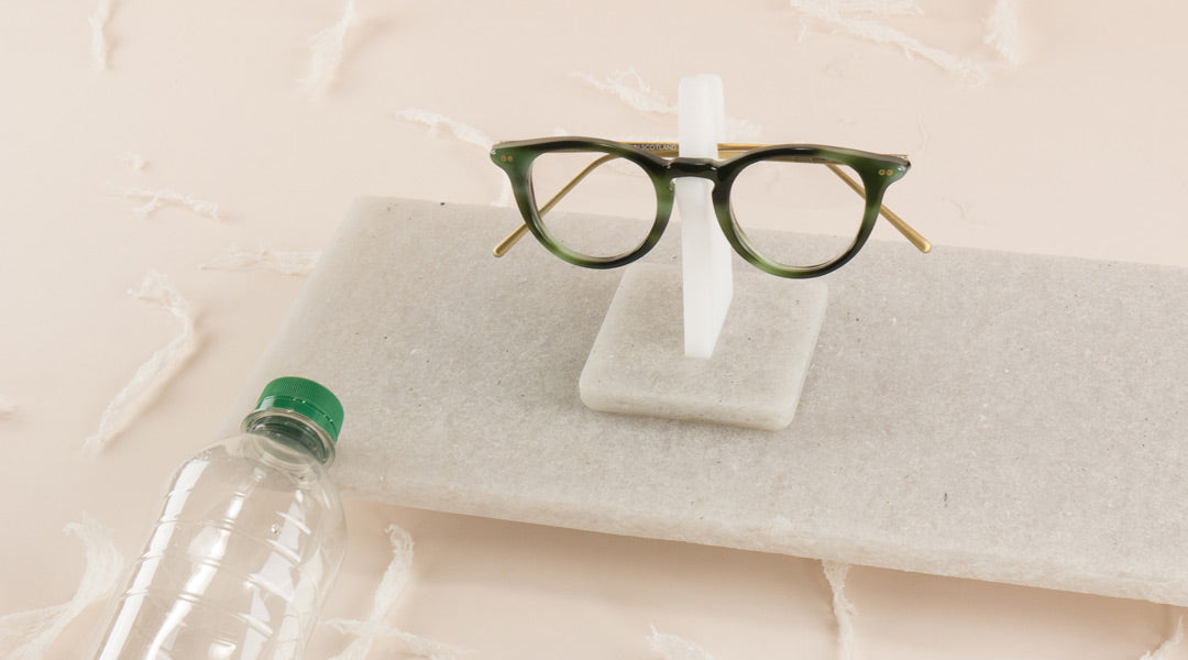 Speactcles resting on an eyeglass stand made from recycled plastic bottles