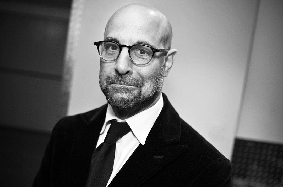 Stanley Tucci wearing suit and glasses