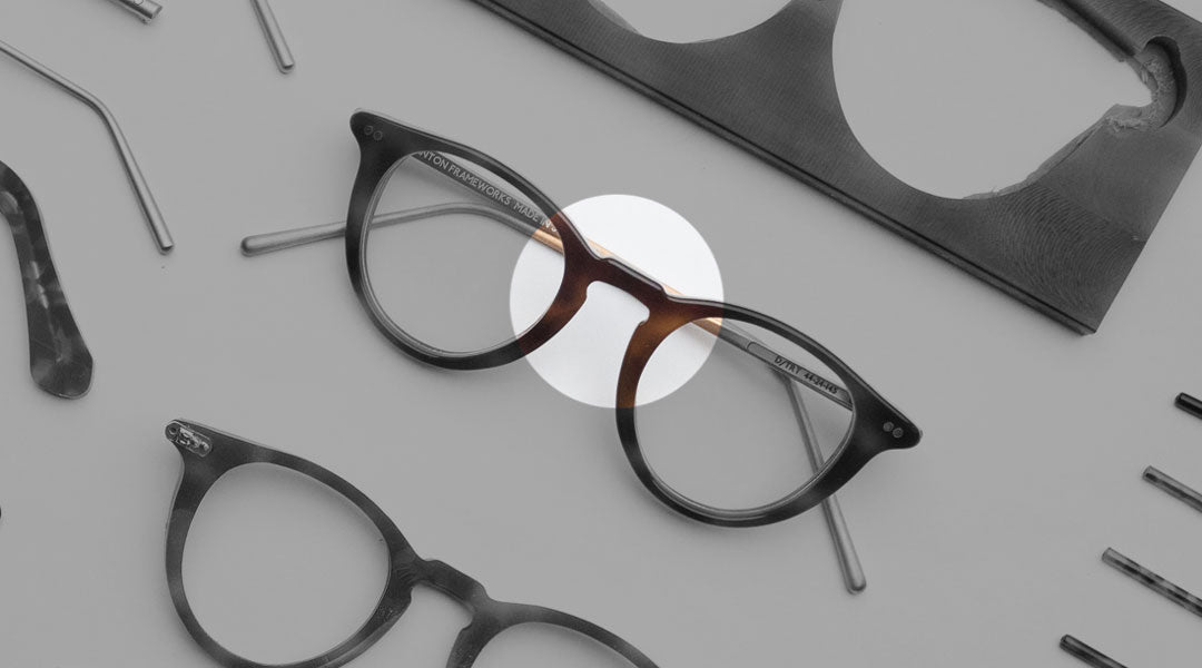 The keyhole bridge of a tortoise acetate glasses frame