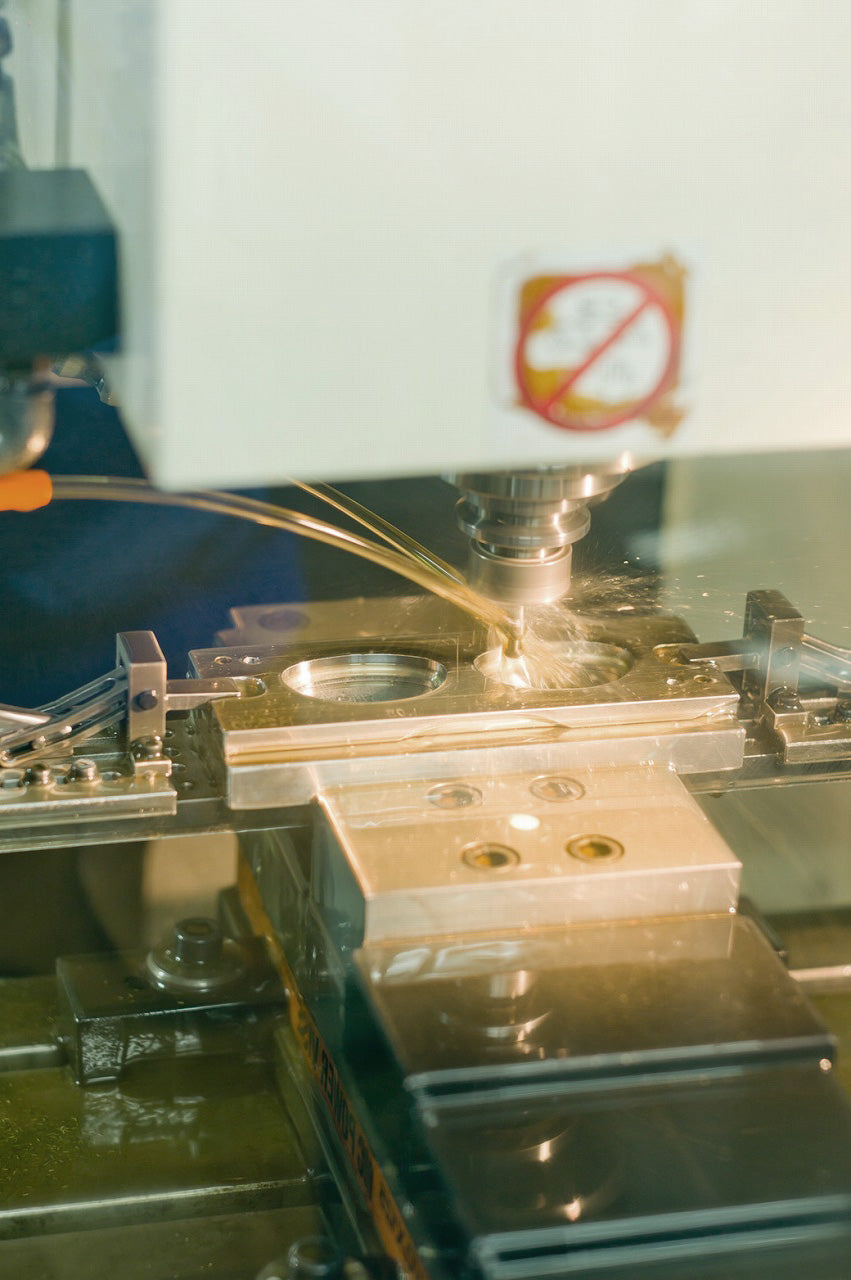 Titanium sunglasses frame being CNC machined from raw material block