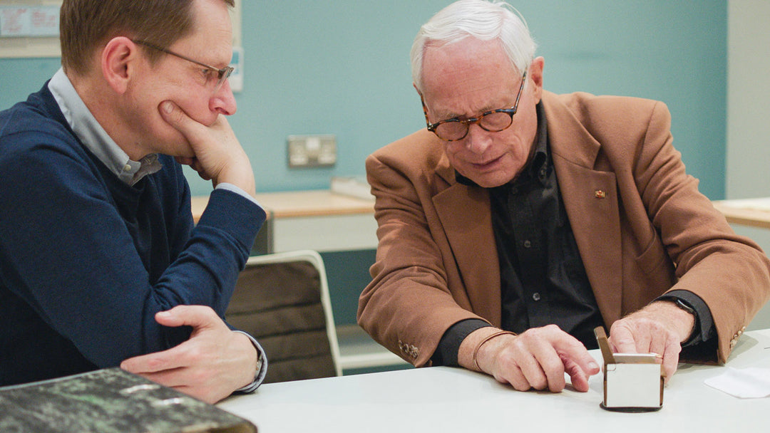 Vitsoe MD Mark Adams talking with Dieter Rams at a table