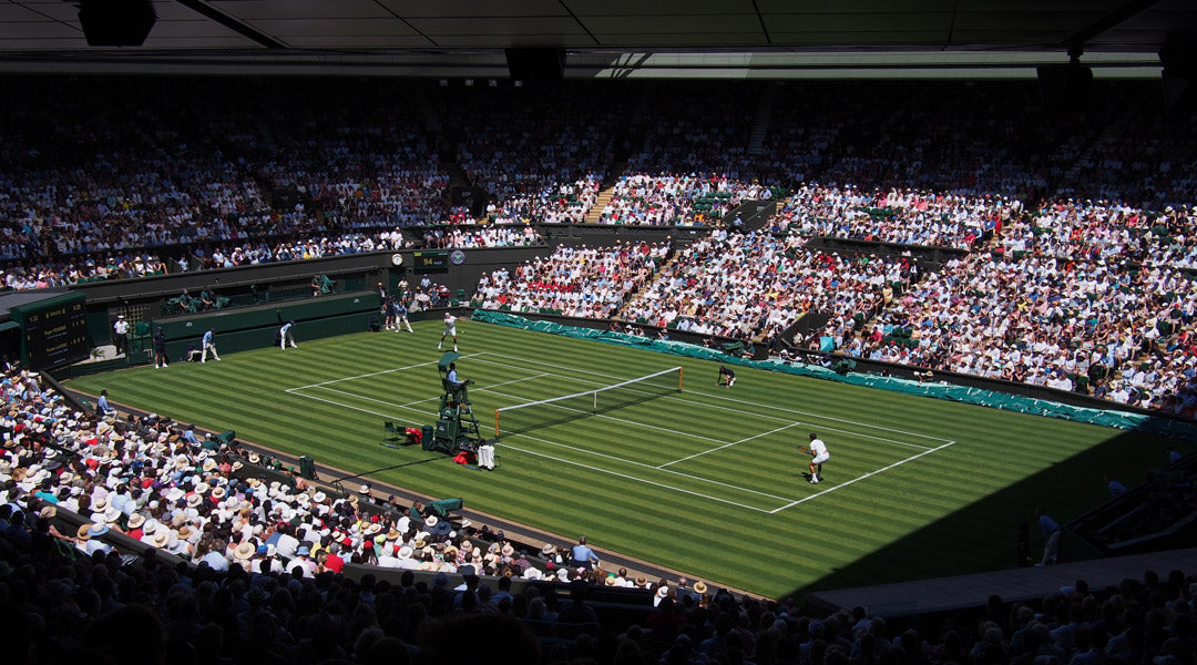 Wimbledon tennis court on bright sunny day singles match