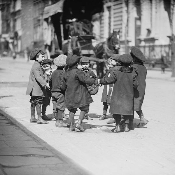 Group of 1800's street children playing together.