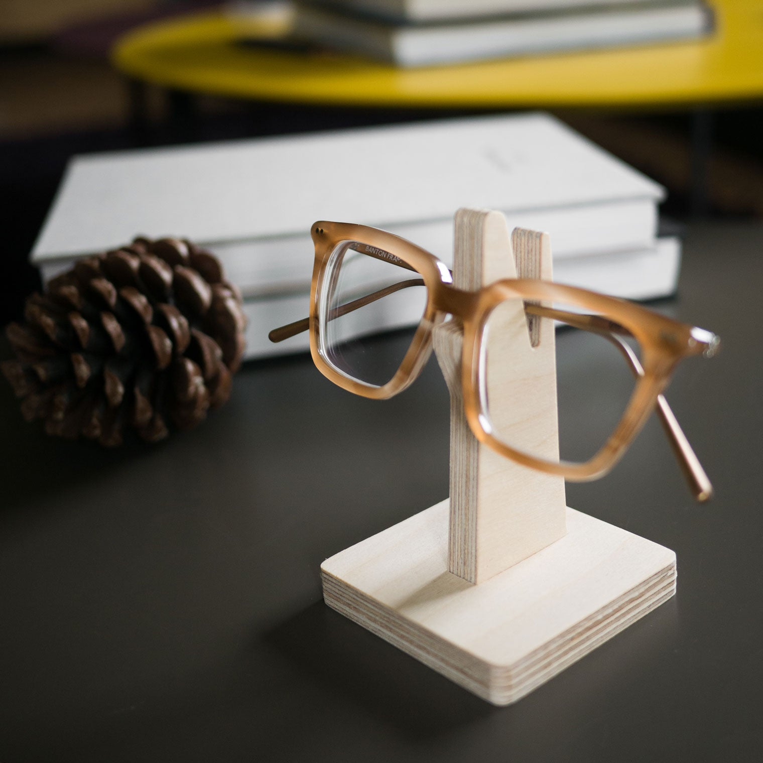 Wooden glasses holder on grey coffee table
