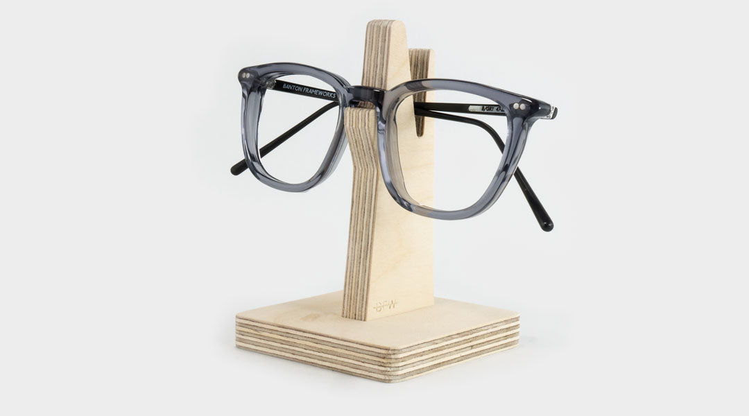 Wooden glasses holder with grey spectacle frame