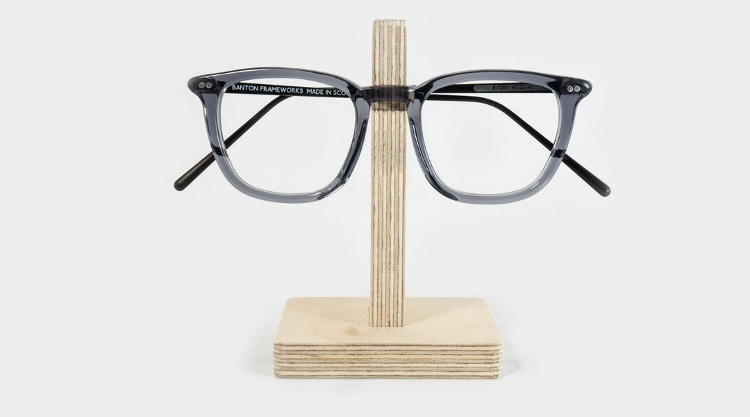 Wooden glasses holder with transparent grey eyeglasses