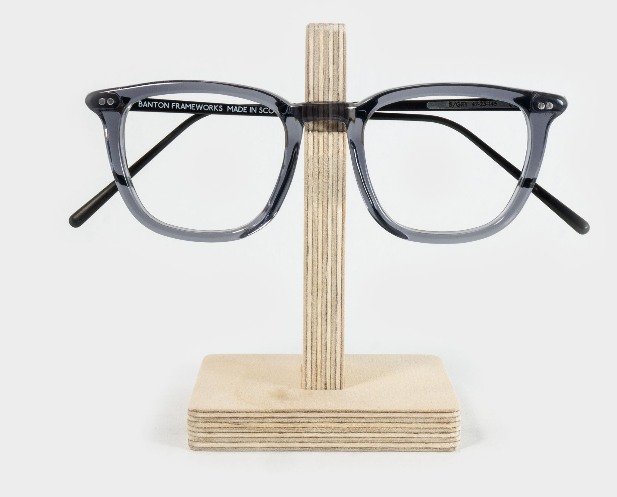 Wooden spectacle holder with glasses front view