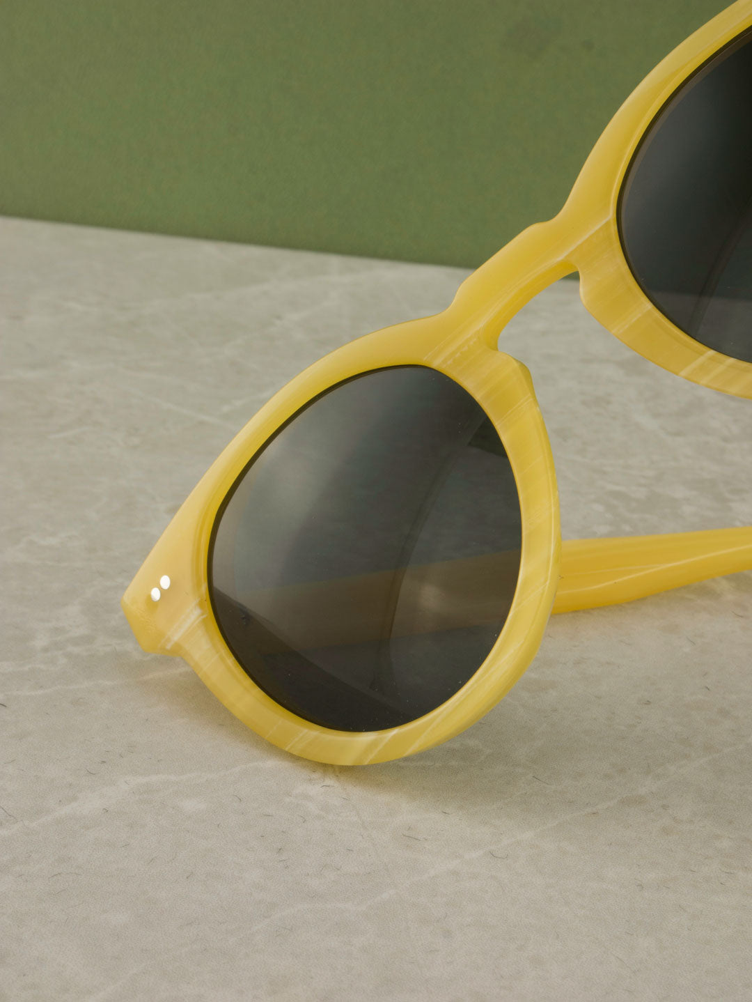 Yellow Galalith sunglasses frame with green lenses