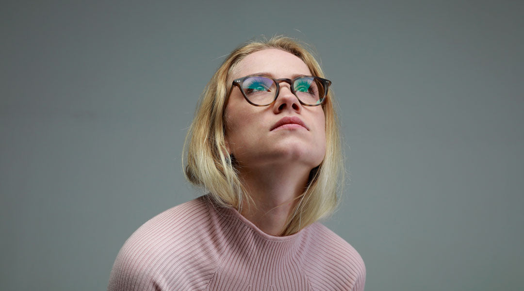 Young blonde woman wearing round tortoise shell glasses