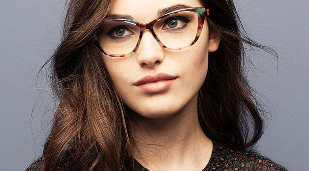 Young dark haired female wearing colourful speckled cat eye glasses