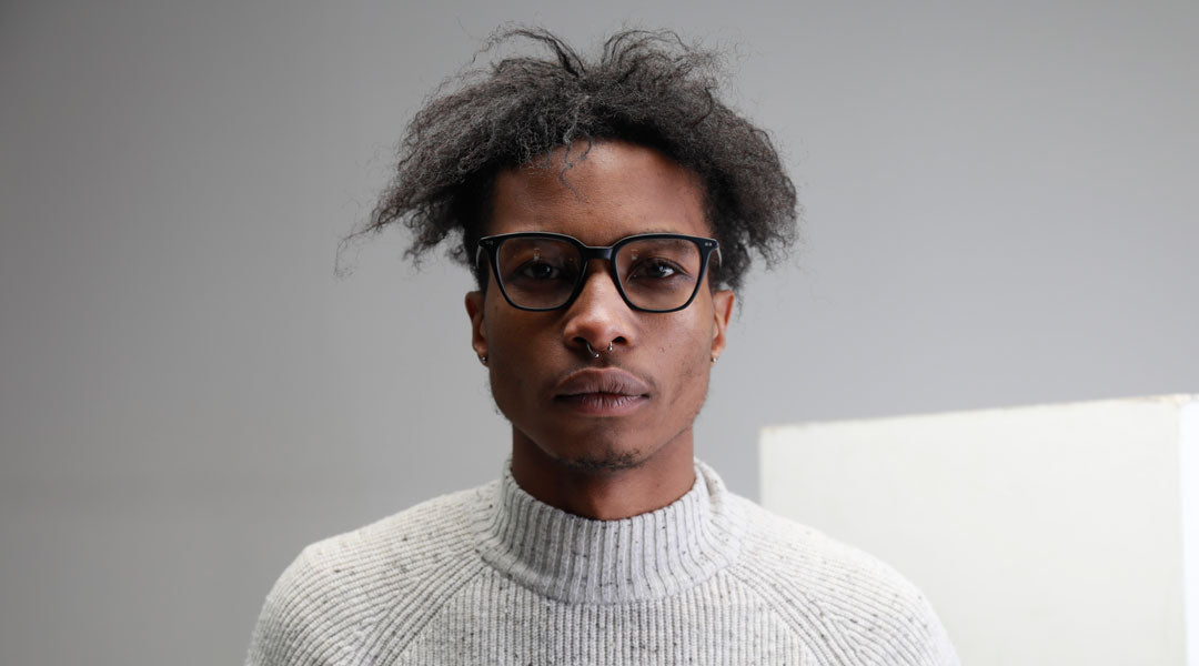 Young man wearing black frame distance glasses