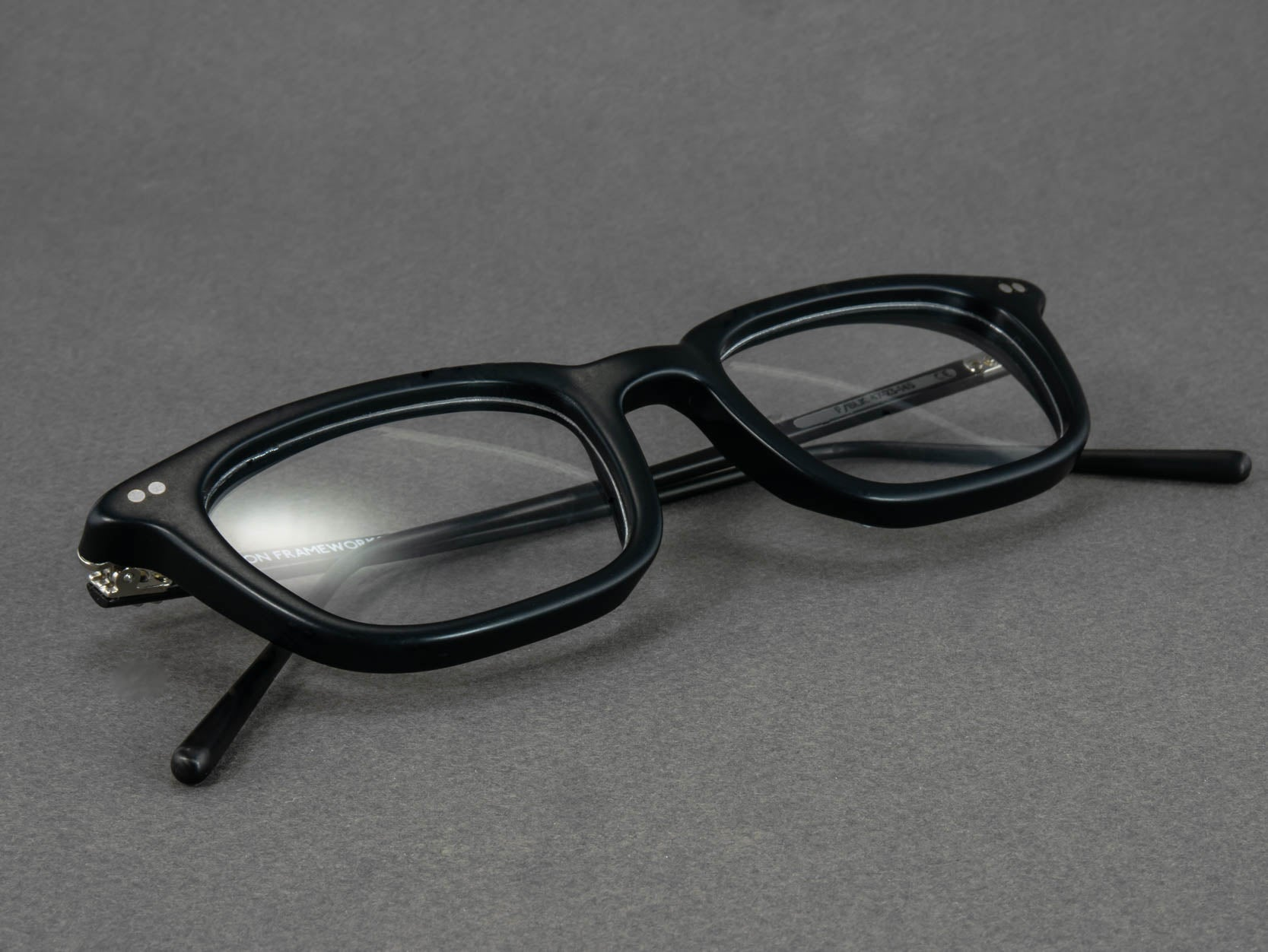 black rectangle optical glasses close up