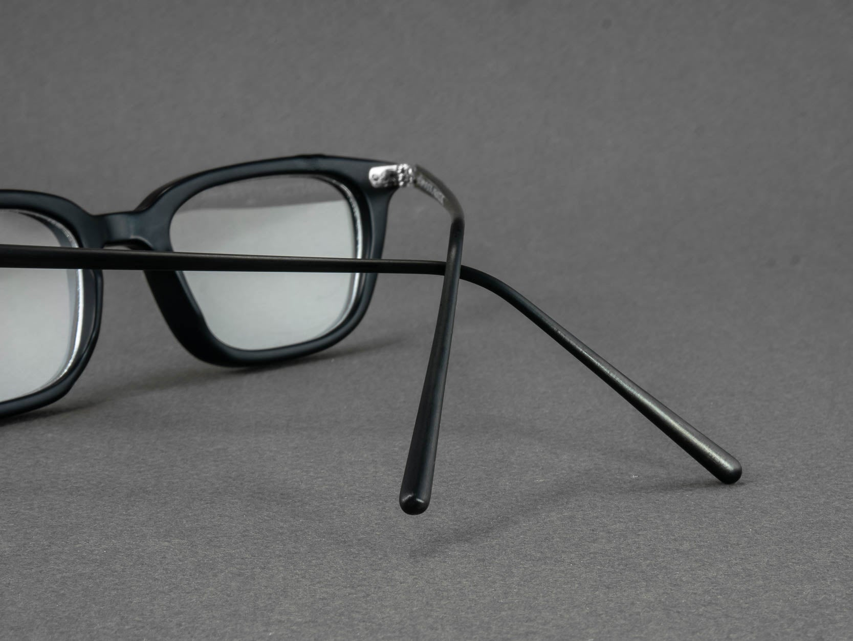 black rectangle optical glasses temple close up