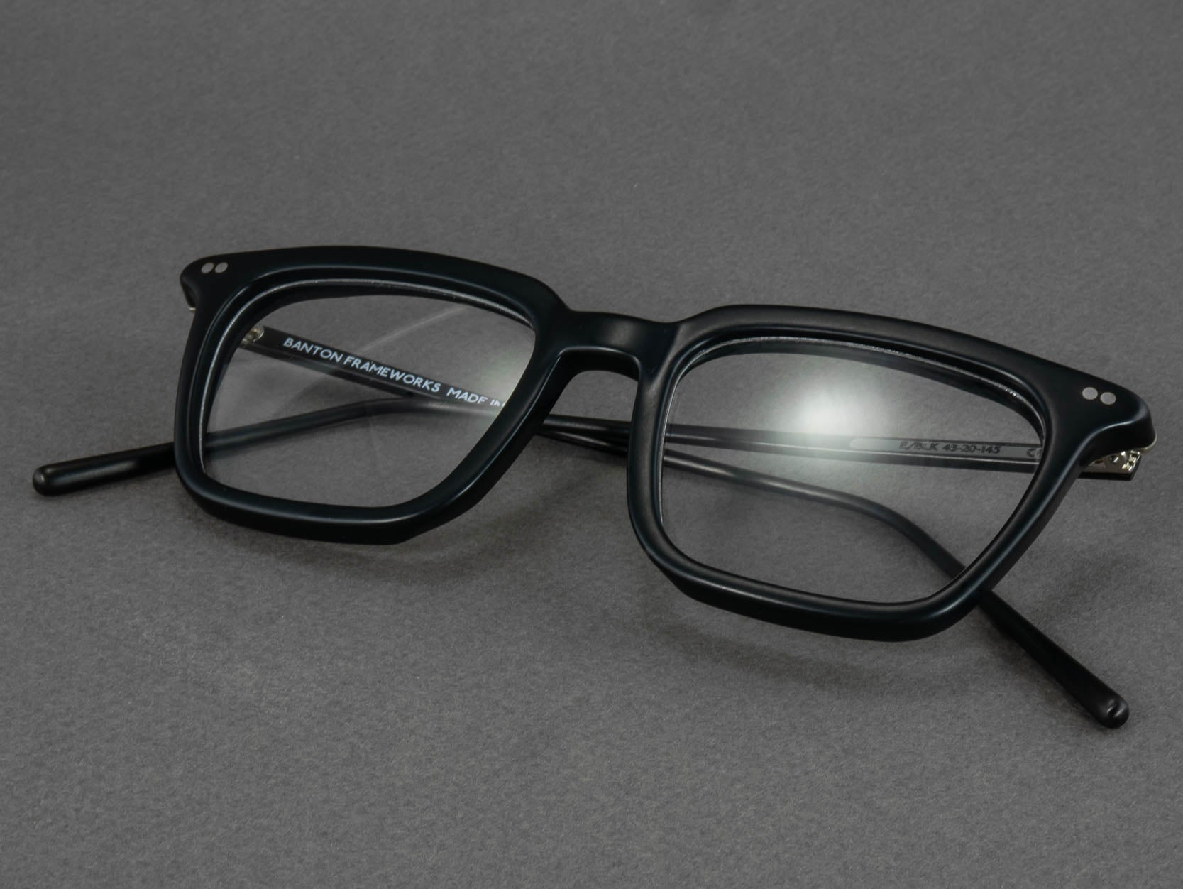 black rectangular optical glasses folded