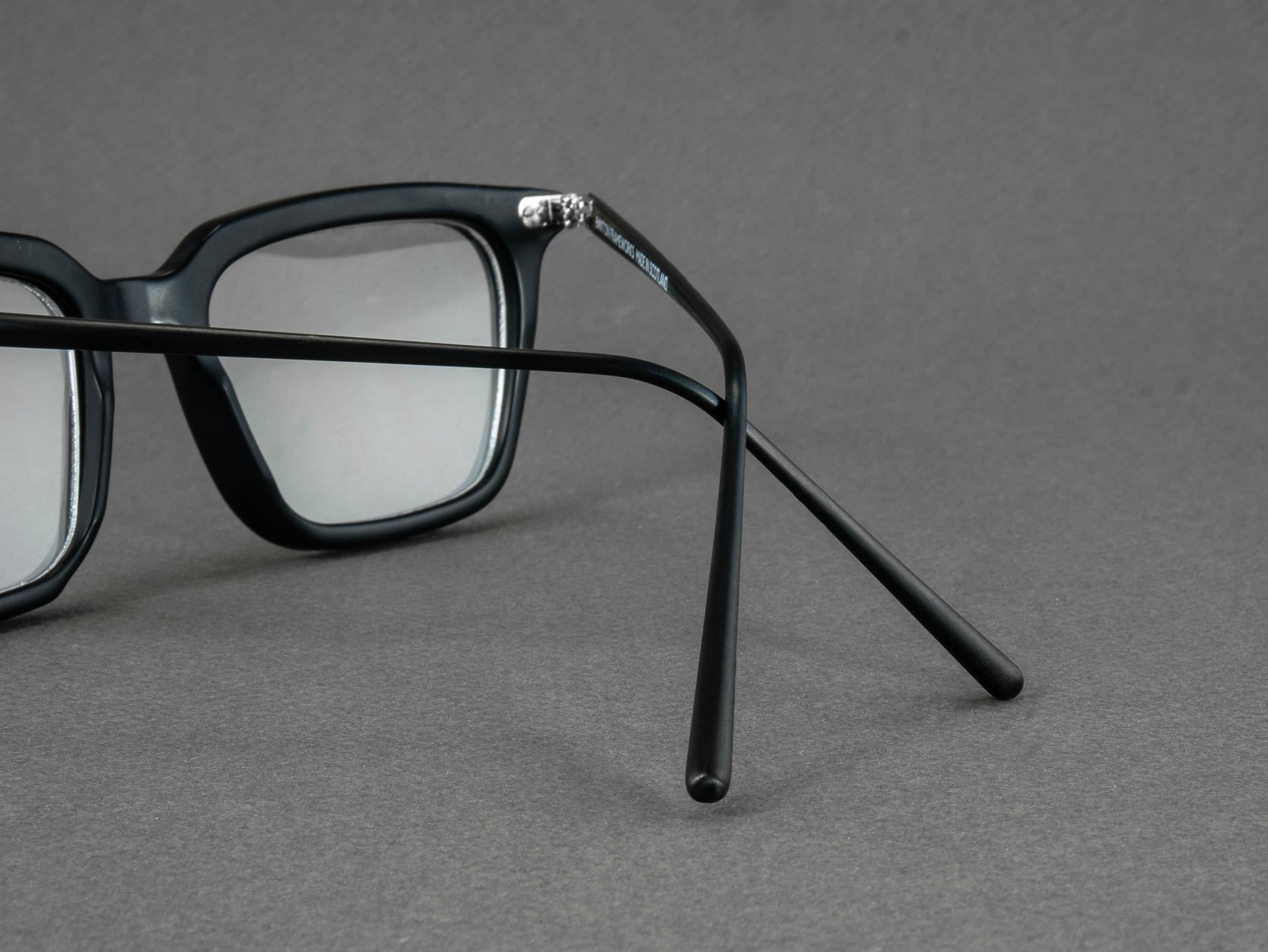 black rectangular optical glasses temple close up