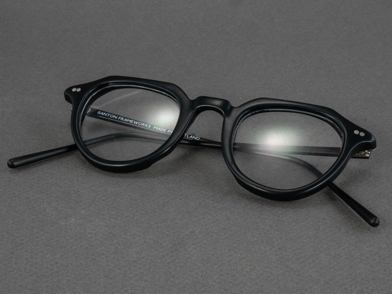 black round optical glasses folded