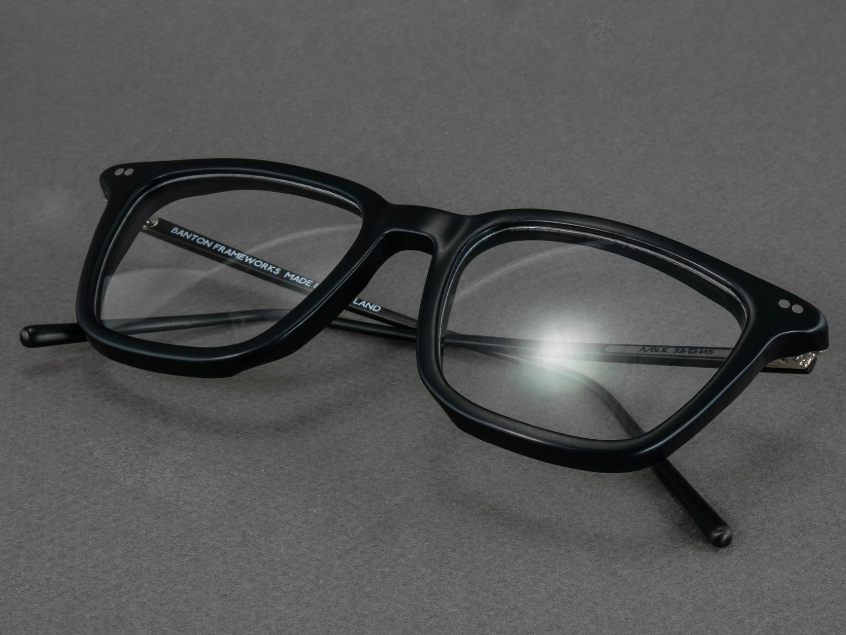 black square optical glasses folded
