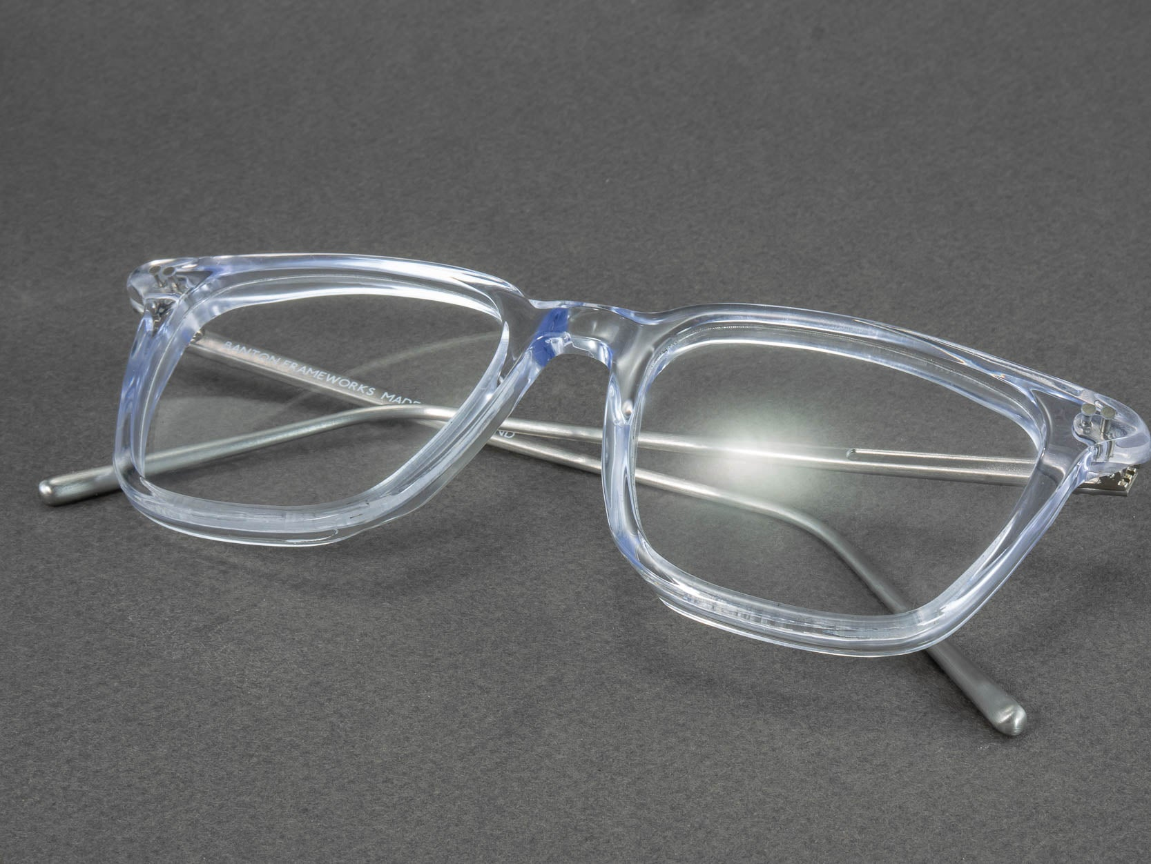 clear frame glasses folded