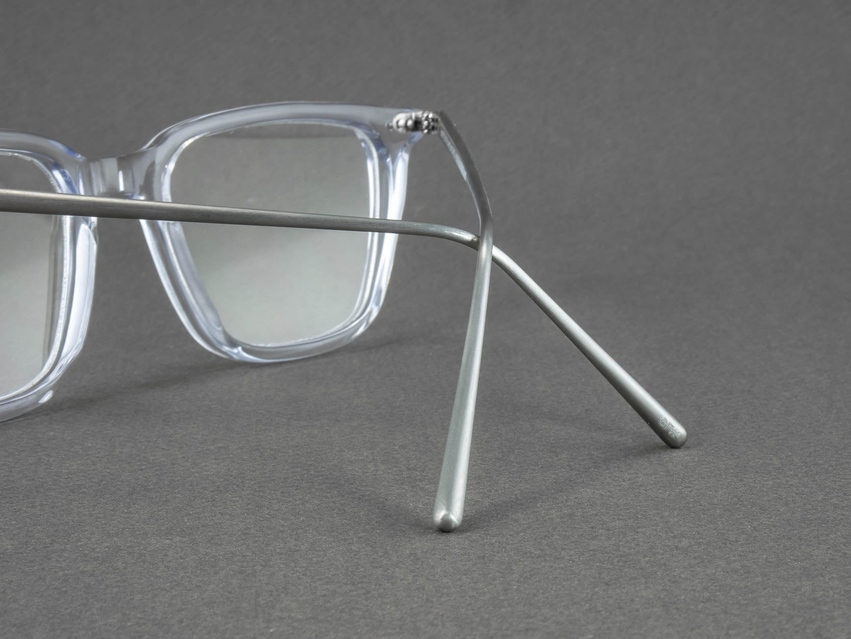 clear frame glasses temple close up