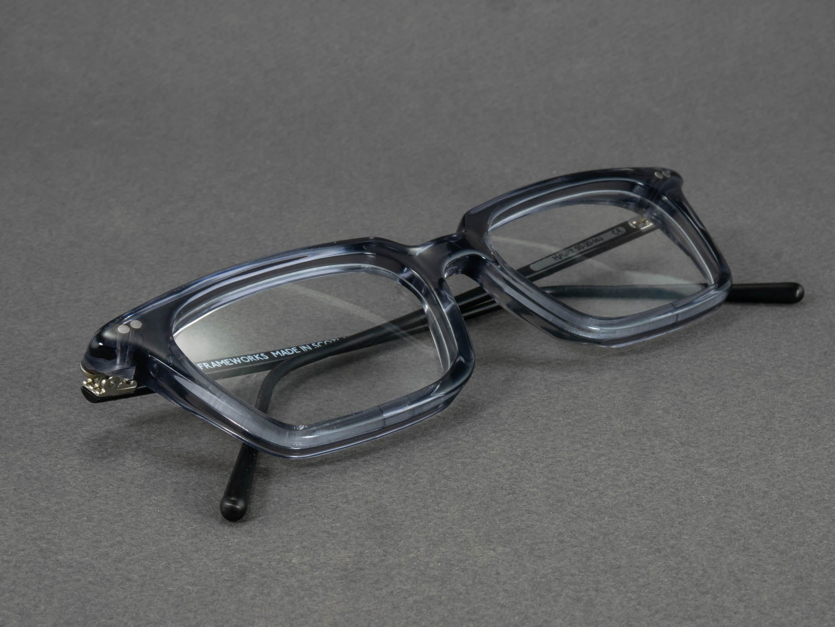 grey rectangular glasses frame close up
