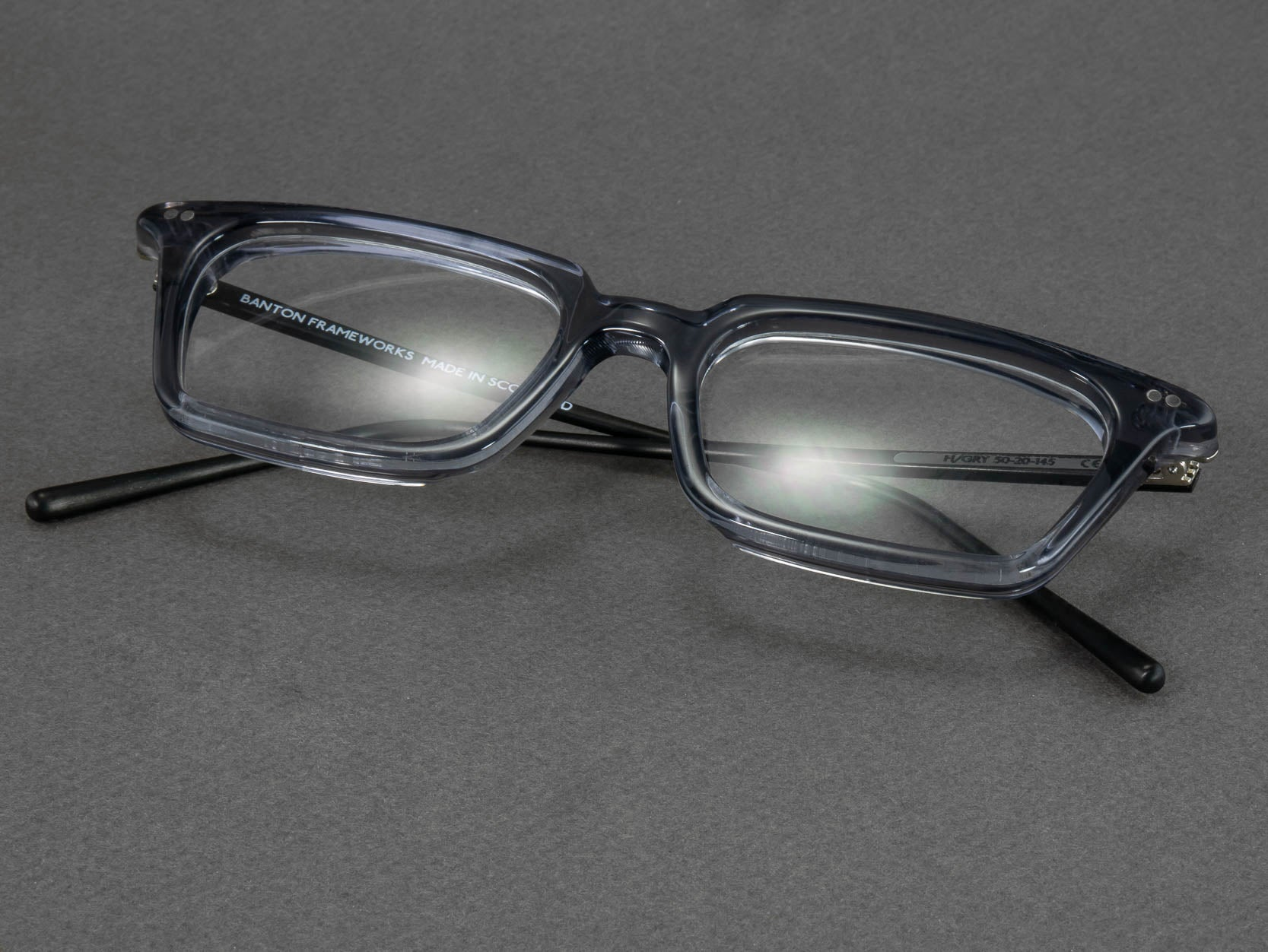 grey rectangular glasses frame folded