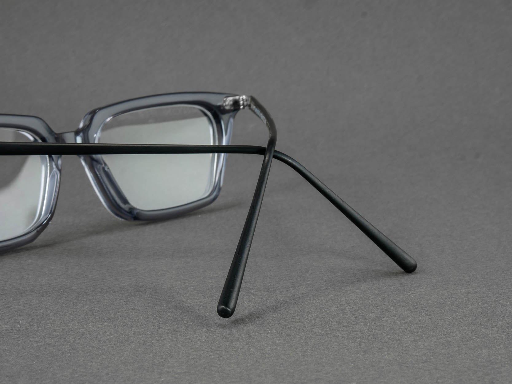 grey rectangular glasses frame temple close up