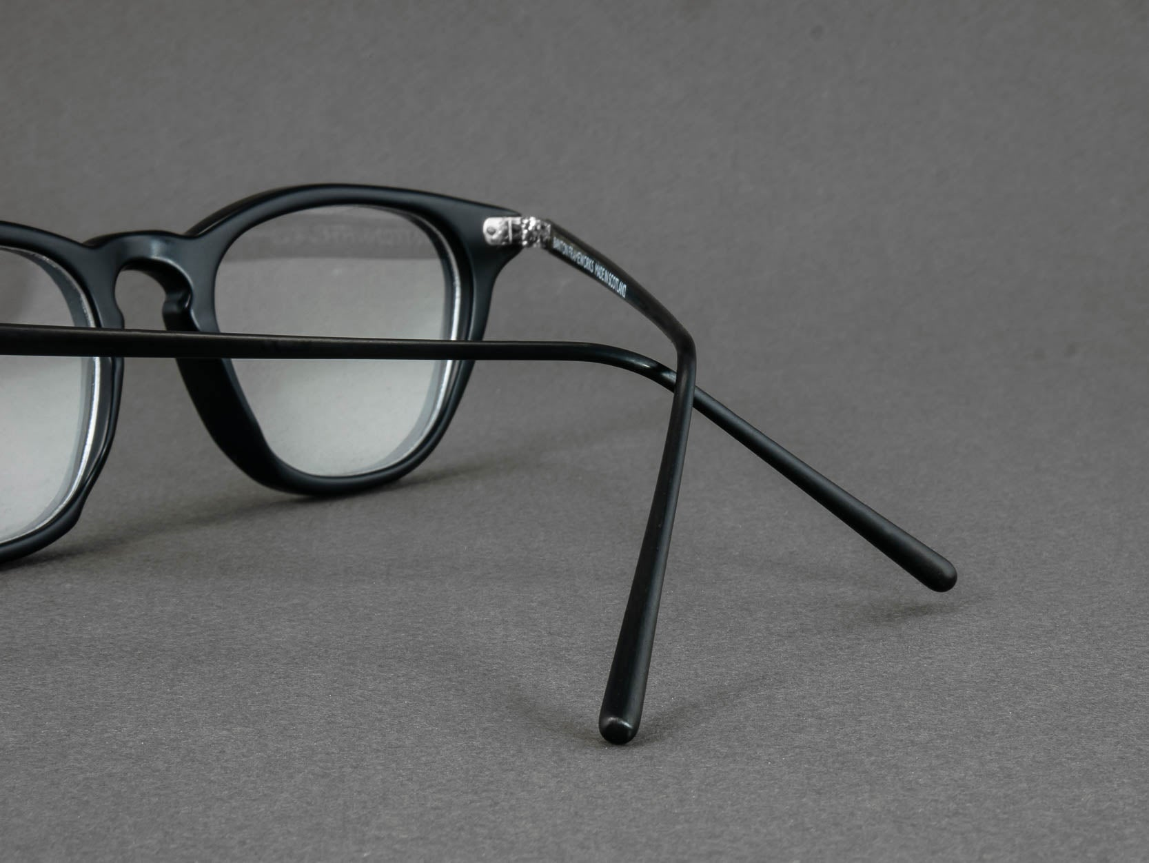 matte black glasses frame temple close up
