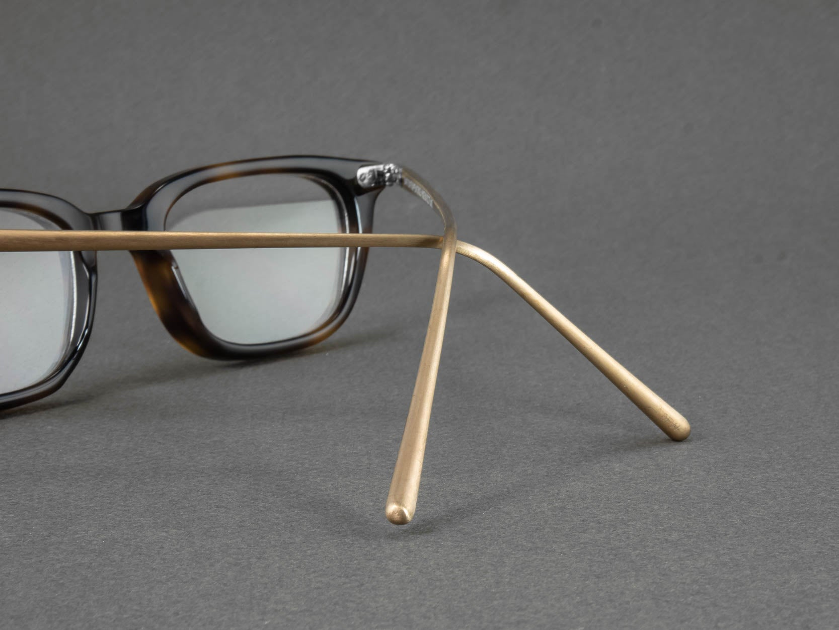 rectangular tortoise shell glasses frame temple close up