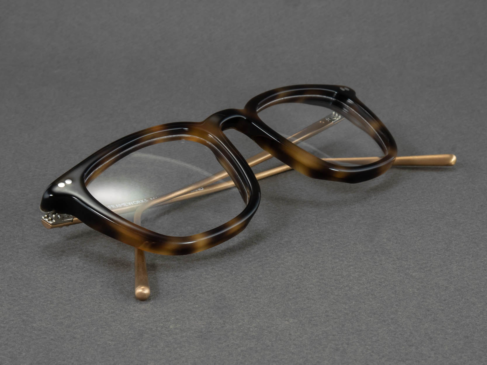 square tortoise_shell glasses close up