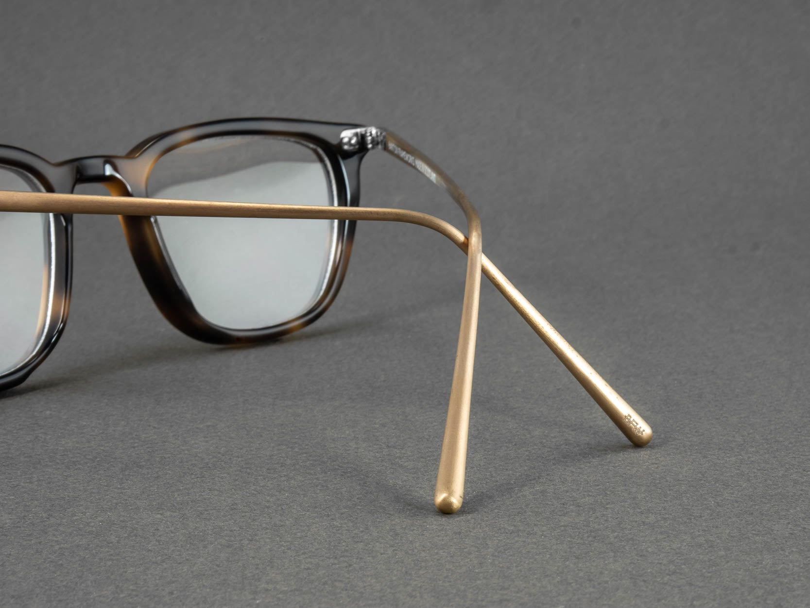 square tortoiseshell glasses temple close up
