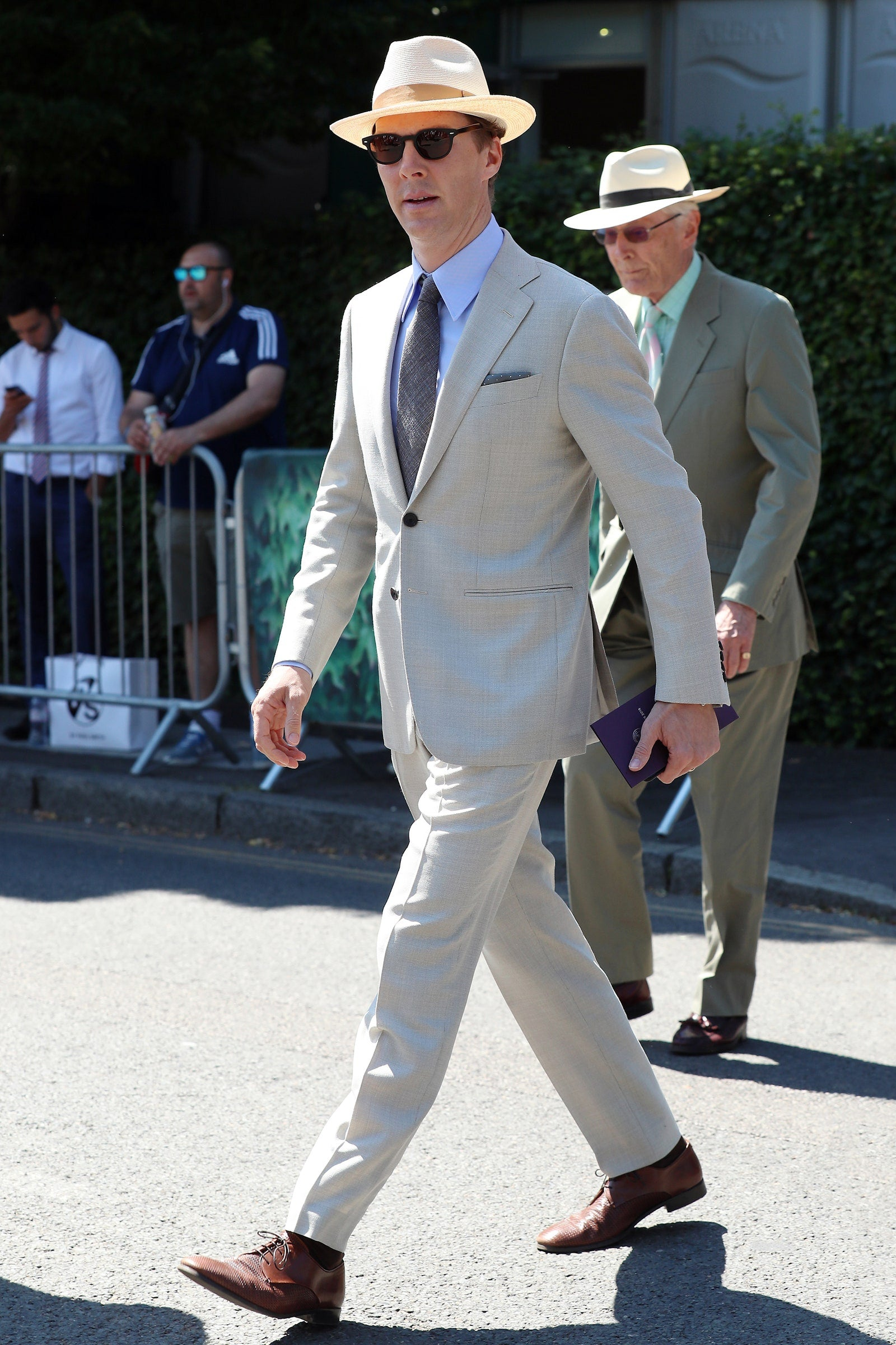 Benedict Cumberbatch in light grey suit, white hat and stylish sunglasses