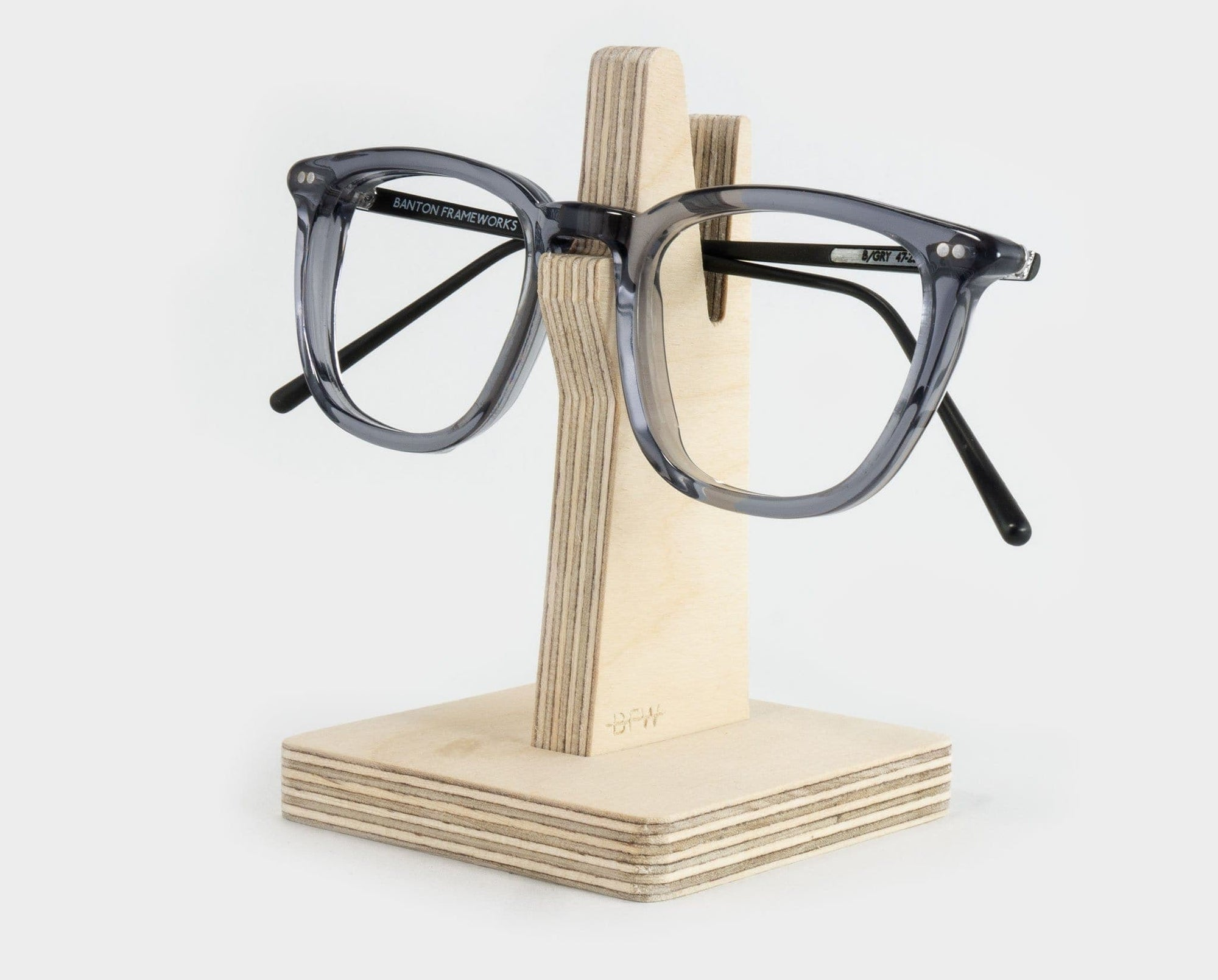 Wooden spectacle holder with glasses