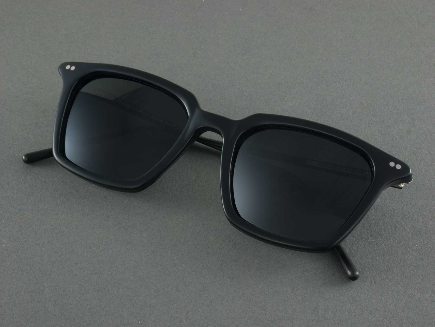 black square polarised sunglasses folded
