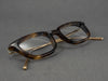 rectangular tortoiseshell glasses frame close up