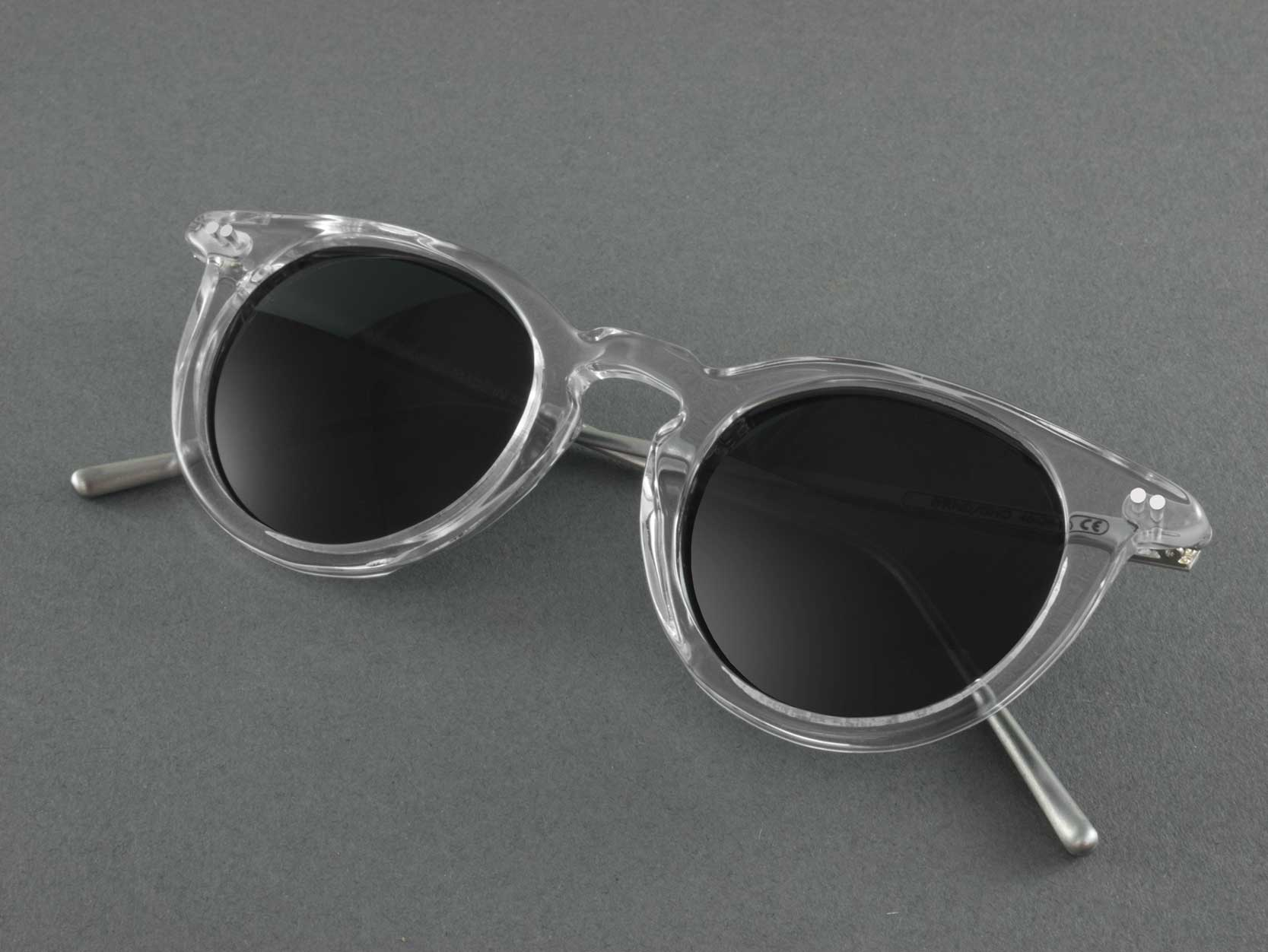 round clear frame polarised sunglasses folded