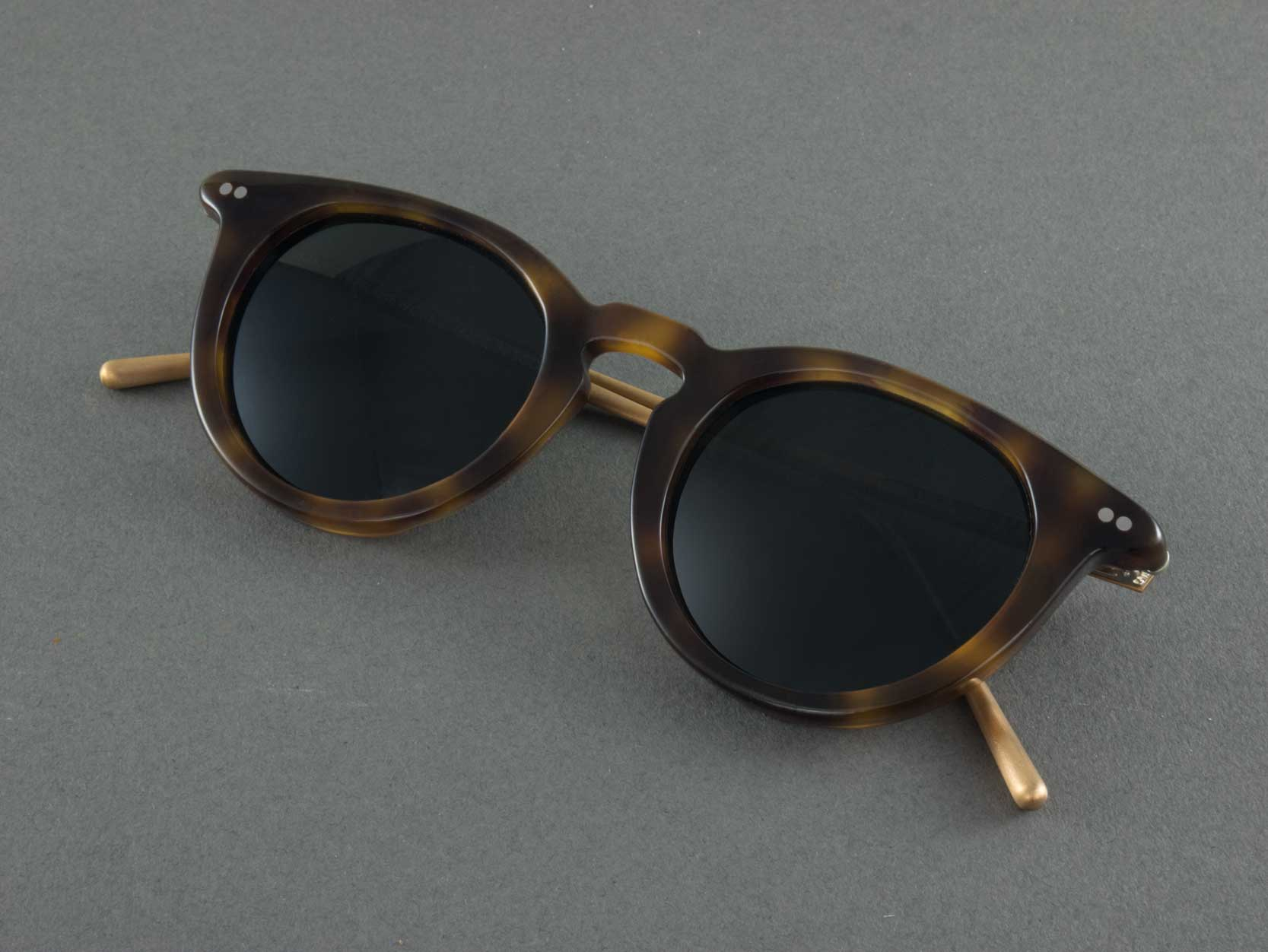 round tortoiseshell polarised sunglasses folded