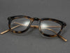 square tortoiseshell glasses folded