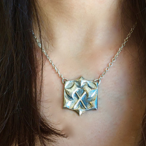 Crossed Hatchets Pendant<br>By Kristen Dorsey