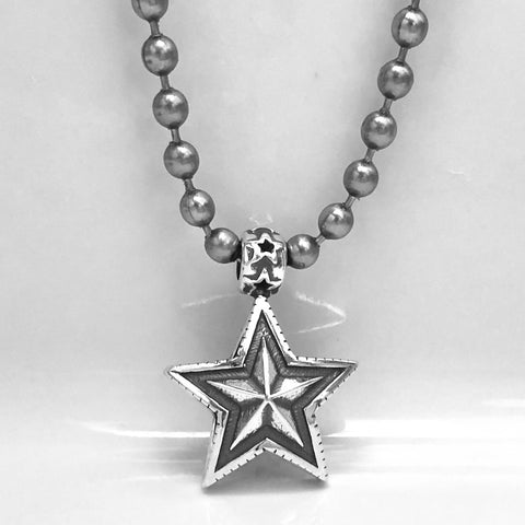 Double Sided Faceted Star<br>By Cody Sanderson