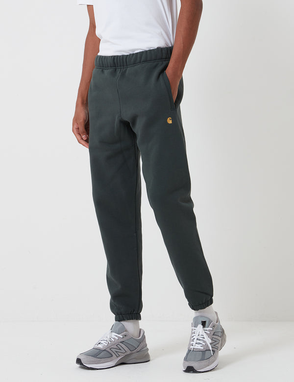 Carhartt-WIP Chase Sweat Pant - Dark Teal/Gold