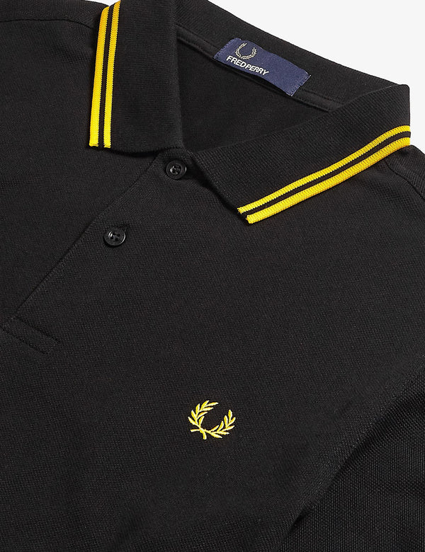 Polo Fred Perry Twin Tipped - Noir/Nouveau Jaune