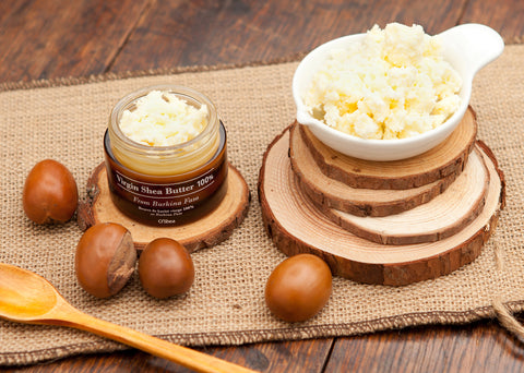 shea butter in containers with seeds, burlap and wood accents