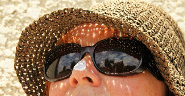woman with sunblock on tip of nose
