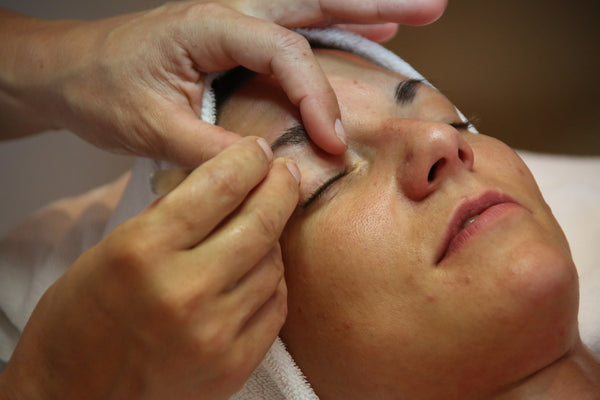 woman receiving skin care treatment