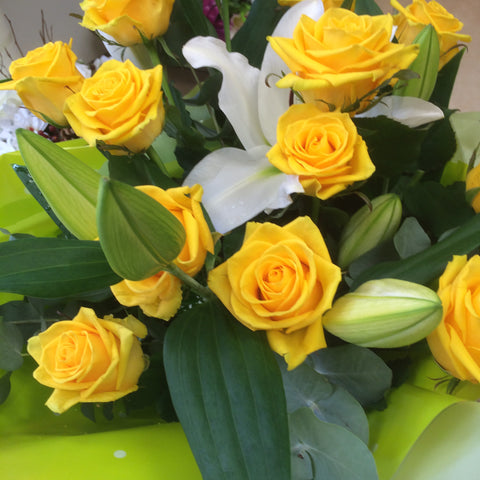Yellow roses and lily golden hues