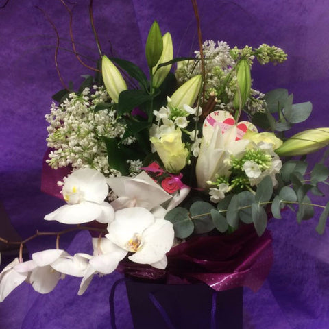Sympathy flowers lilies roses and orchids