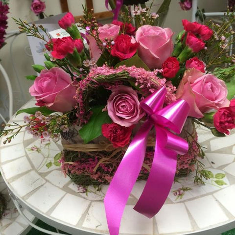Basket of roses and carnations