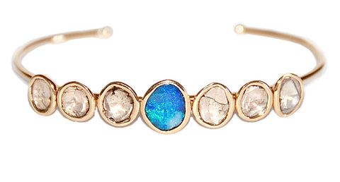 18kt mine cut diamond with opal cuff
