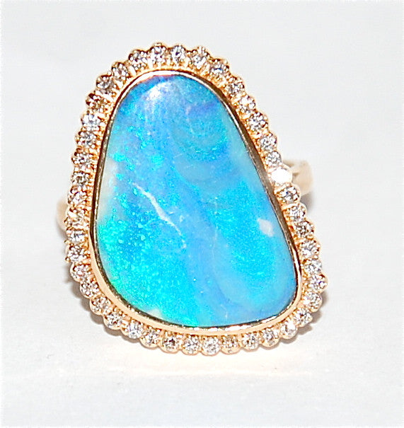 18kt Gold opal with diamond marque ring